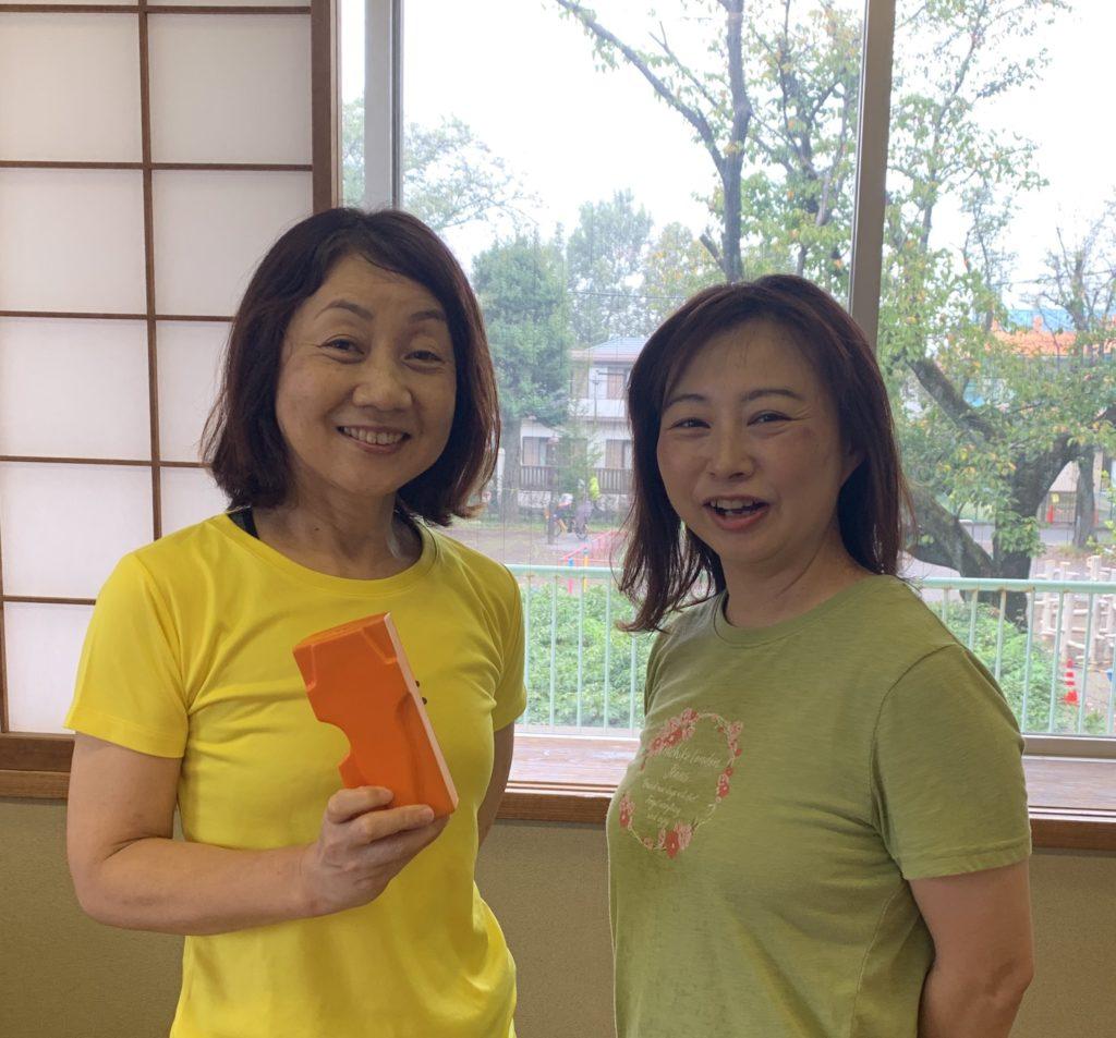 黒田先生とお客様、笑顔の写真